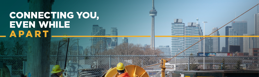 Banner image of two Toronto Hydro field workers against the backdrop of the Toronto skyline, with the tagline of 'Connecting you even while apart'